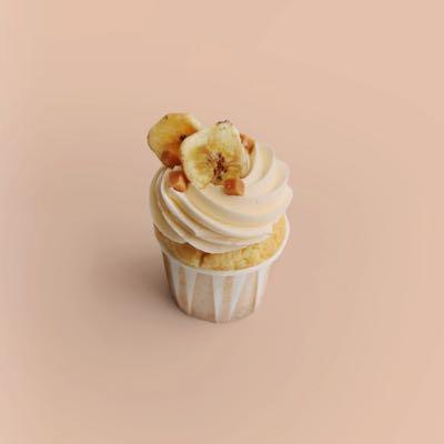 Cupcake mit Banane und Karamellkern